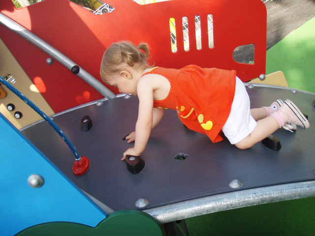 children are climbing in the playground of camping by the sea, near (...)