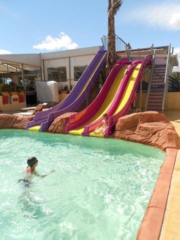 Slides and waterslides in the holiday village near the Mediterranean (...)